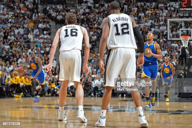 Pau Gasol and LaMarcus Aldridge of the San Antonio Spurs stand on the court in Game Three of the Western Conference Finals against the Golden State...