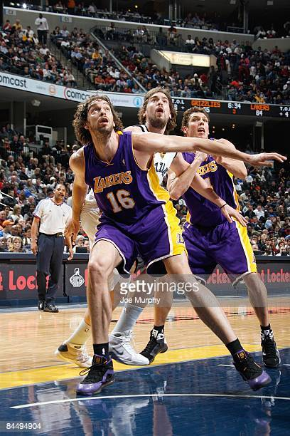 Pau Gasol and Luke Walton of the Los Angeles Lakers guard Marc Gasol of the Memphis Grizzlies during the game on December 22 2008 at FedExForum in...