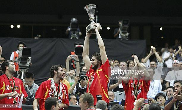 Pau Gasol and Marc Gasol of Spain celebrate their victory with a trophy during a ceremony at 2006 FIBA World Championship on September 3 2006 in...