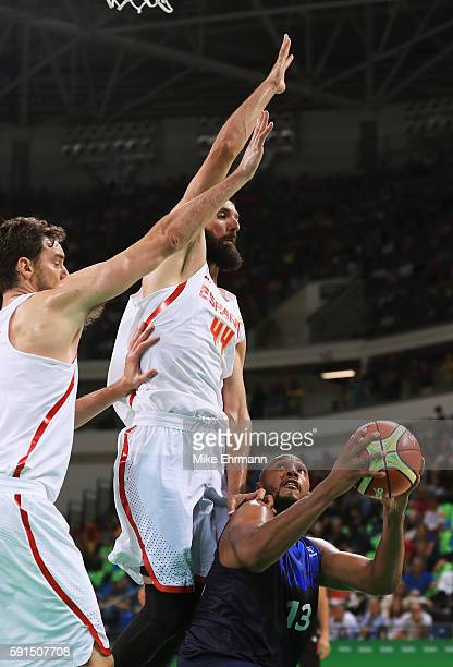 Pau Gasol and Nikola Mirotic of Spain defend against Boris Diaw of France during the Men's Quarterfinal match on Day 12 of the Rio 2016 Olympic Games...