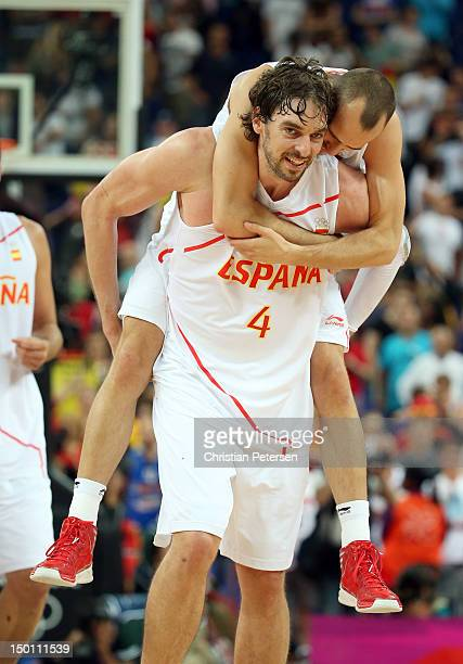 Pau Gasol and Sergio Rodriguez of Spain celebrate after they won 6759 against Russia during the Men's Basketball semifinal match on Day 14 of the...
