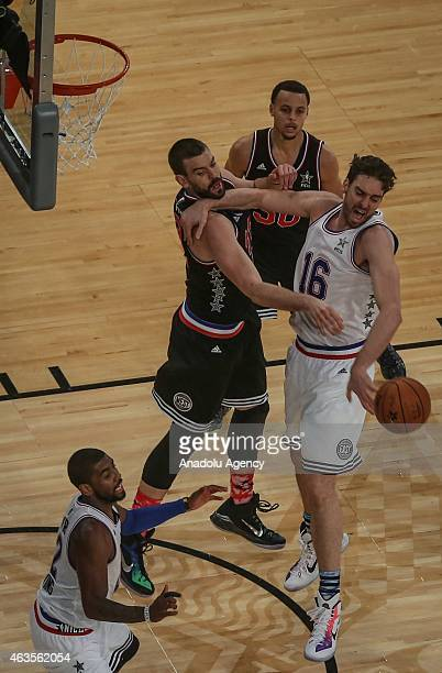 Pau Gasol of Eastern Conference AllStar Team in action against Stephen Curry and Marc Gasol of Western Conference AllStar Team during the 64th NBA...