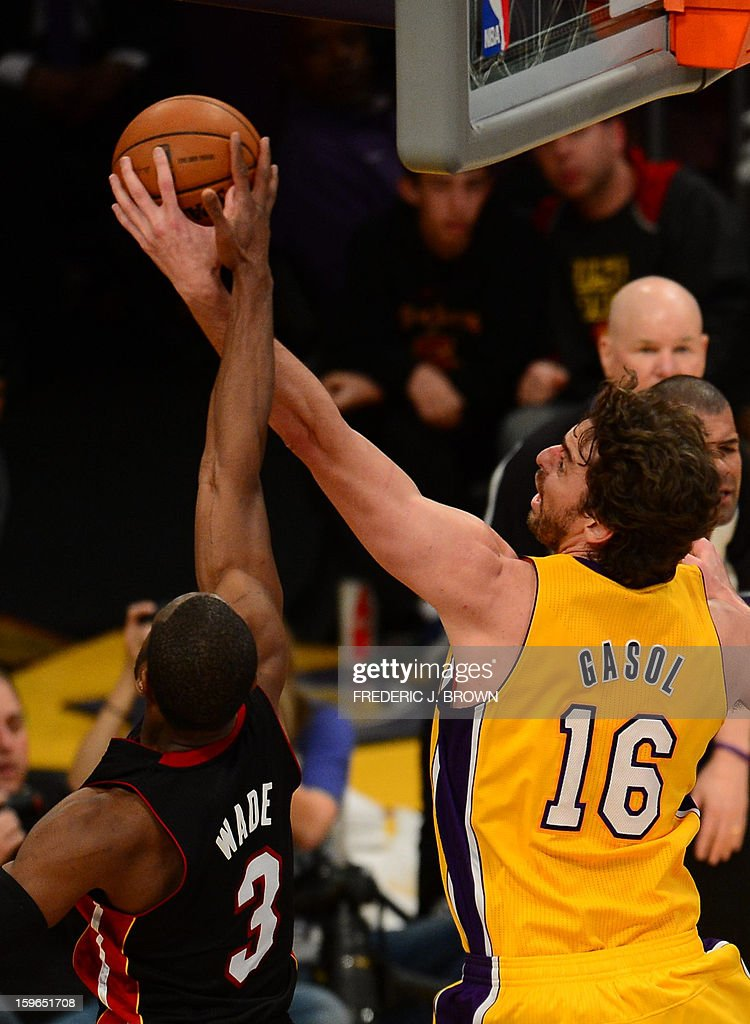 Pau Gasol (R) of Los Angeles Lakers and Dwyane Wade vie for the ball during their NBA game on January 17, 2013 in Los Angeles, California. AFP PHOTO / Frederic J. BROWN