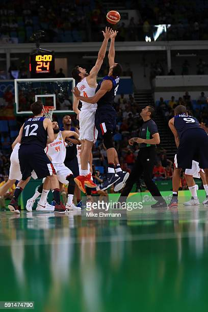 Pau Gasol of Spain and Rudy Gobert of France jump for the ball during the Men's Quarterfinal match on Day 12 of the Rio 2016 Olympic Games at Carioca...