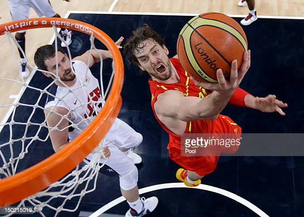 Pau Gasol of Spain drives past Kevin Love of the United States to score during the Men's Basketball Gold medal game between the United States and...