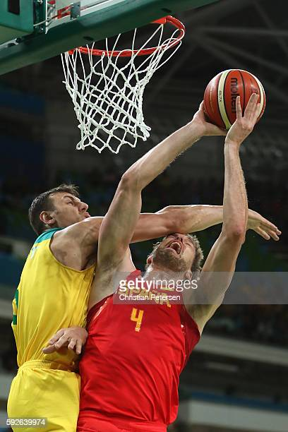 Pau Gasol of Spain drives to the basket against Andrew Bogut of Australia during the Men's Basketball Bronze medal game between Australia and Spain...