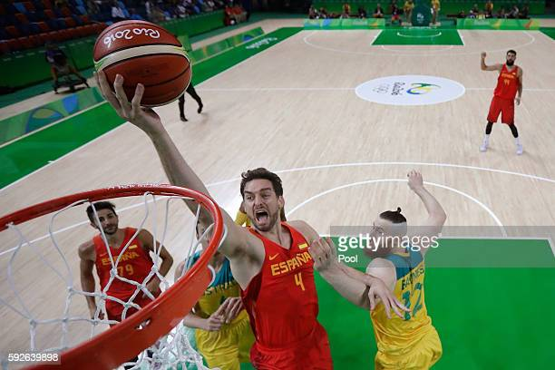 Pau Gasol of Spain drives to the basket against Aron Baynes of Australia during the Men's Basketball Bronze medal game between Australia and Spain on...