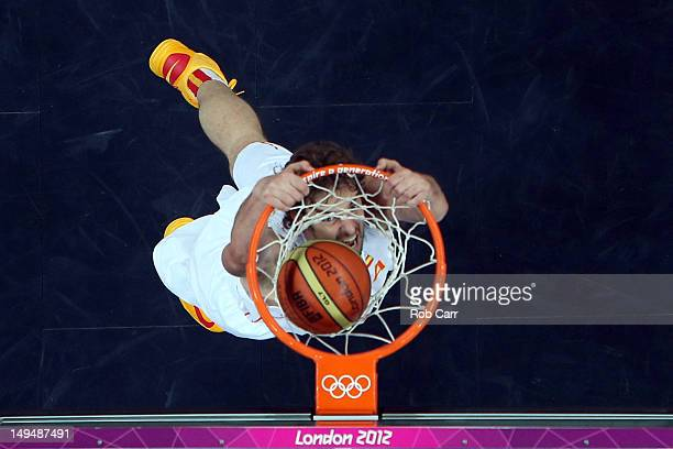 Pau Gasol of Spain dunks the ball against China during their Men's Basketball Game on Day 2 of the London 2012 Olympic Games at the Basketball Arena...