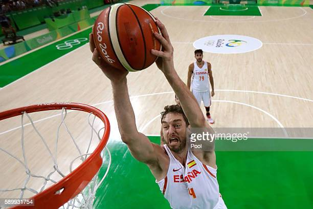 Pau Gasol of Spain dunks the ball during a Men's Basketball Preliminary Round Group B game between Spain and Argentina on Day 10 of the Rio 2016...