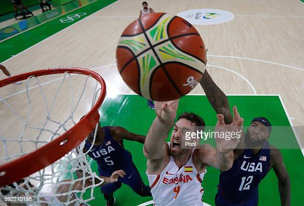 Pau Gasol of Spain goes to the basket against Demarcus Cousins of United States during the Men's Semifinal match on Day 14 of the Rio 2016 Olympic...