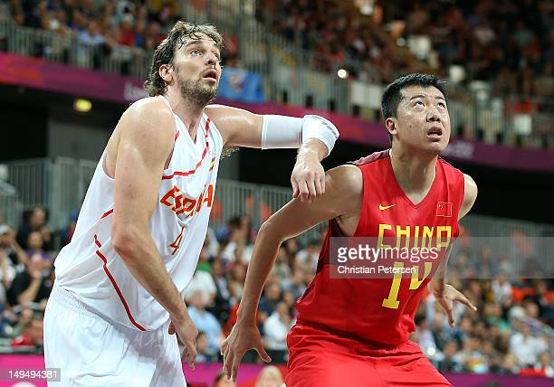 Pau Gasol of Spain looks for the ball against Zhizhi Wang of China during their Men's Basketball Game on Day 2 of the London 2012 Olympic Games at...