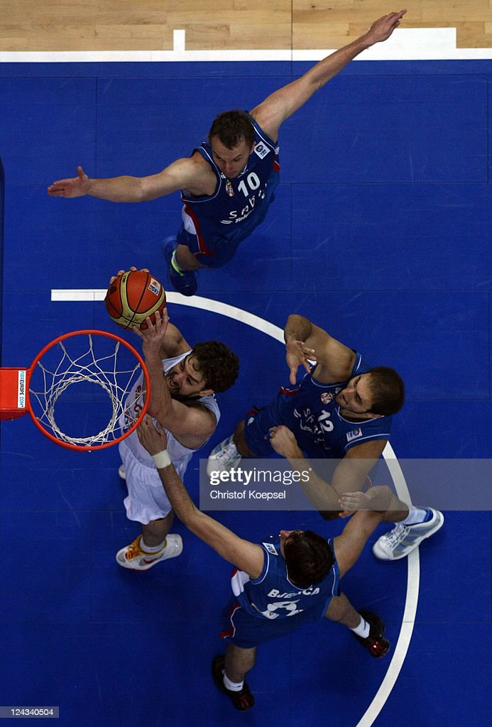 <a gi-track='captionPersonalityLinkClicked' href=/galleries/search?phrase=Pau+Gasol&family=editorial&specificpeople=201587 ng-click='$event.stopPropagation()'>Pau Gasol</a> of Spain scores against Dusko Savanovic, Nemanja Bjelica and <a gi-track='captionPersonalityLinkClicked' href=/galleries/search?phrase=Nenad+Krstic&family=editorial&specificpeople=202625 ng-click='$event.stopPropagation()'>Nenad Krstic</a> of Serbia during the EuroBasket 2011 second round group E match between Spain and Serbia at Siemens Arena on September 9, 2011 in Vilnius, Lithuania.