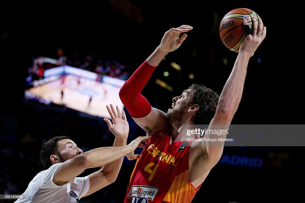 <a gi-track='captionPersonalityLinkClicked' href=/galleries/search?phrase=Pau+Gasol&family=editorial&specificpeople=201587 ng-click='$event.stopPropagation()'>Pau Gasol</a> of Spain shoots against <a gi-track='captionPersonalityLinkClicked' href=/galleries/search?phrase=Joffrey+Lauvergne&family=editorial&specificpeople=6828069 ng-click='$event.stopPropagation()'>Joffrey Lauvergne</a> of France during the 2014 FIBA World Basketball Championship quarter final match between France and Spain at Palacio de los Deportes on September 10, 2014 in Madrid, Spain.