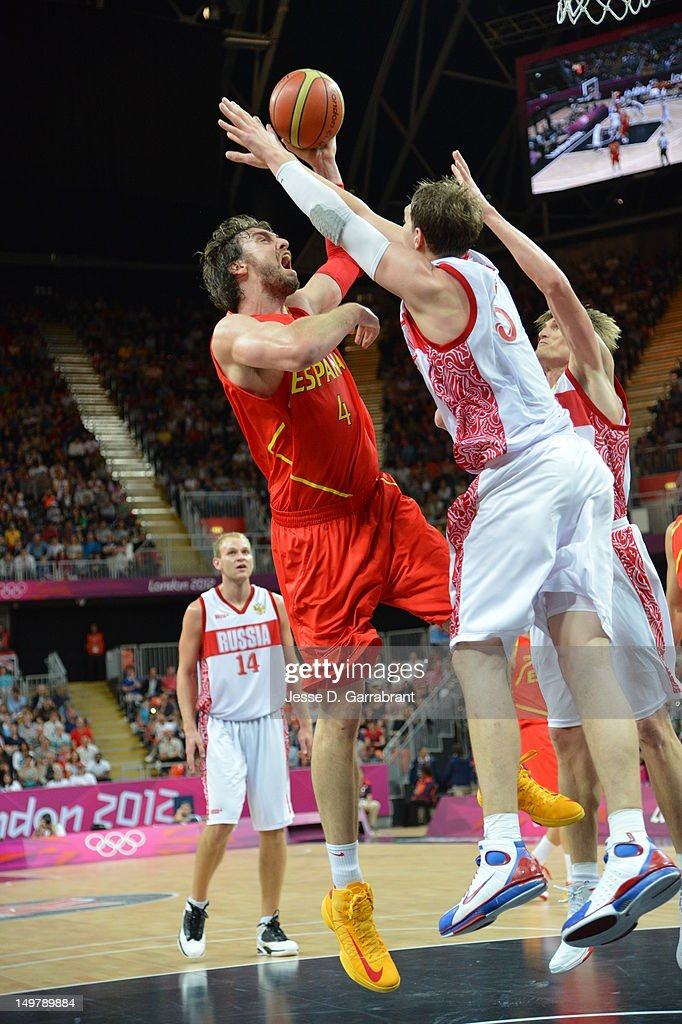 <a gi-track='captionPersonalityLinkClicked' href=/galleries/search?phrase=Pau+Gasol&family=editorial&specificpeople=201587 ng-click='$event.stopPropagation()'>Pau Gasol</a> #4 of Spain shoots against Russia during their Basketball Game on Day 6 of the London 2012 Olympic Games at the Olympic Park Basketball Arena on August 4, 2012 in London, England.