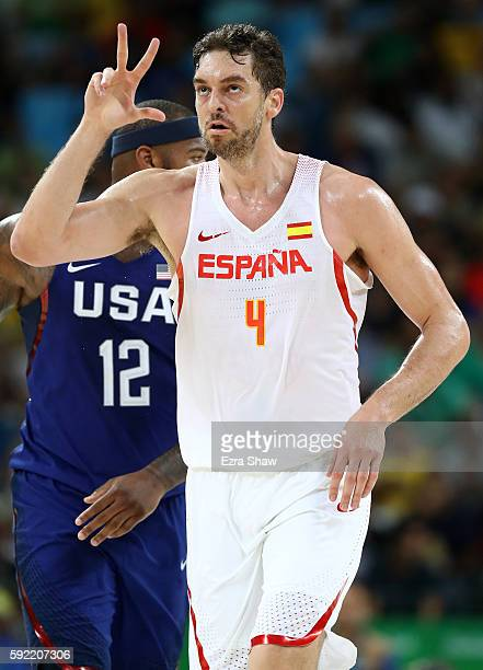 Pau Gasol of Spain signals a made shot ahead of Demarcus Cousins of United States during the Men's Semifinal match on Day 14 of the Rio 2016 Olympic...