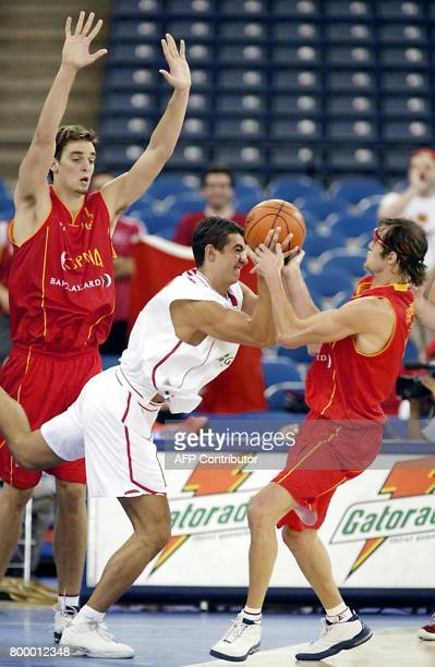 Pau Gasol of Spain watches as Ibrahim Ibo Kutluay of Turkey and Lucio Angulo of Spain fight for the lose ball 02 September 2002 during the second...