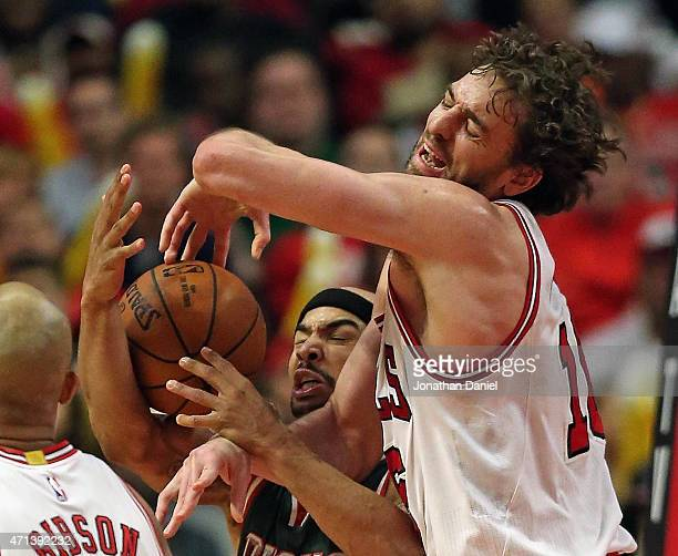 Pau Gasol of the Chicago Bulls and Jerryd Bayless of the Milwaukee Bucks battle for a rebound during the first round of the 2015 NBA Playoffs at the...