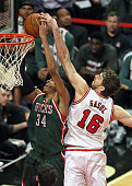 Pau Gasol of the Chicago Bulls blocks a shot by Giannis Antetokounmpo of the Milwaukee Bucks at the United Center on February 23 2015 in Chicago...