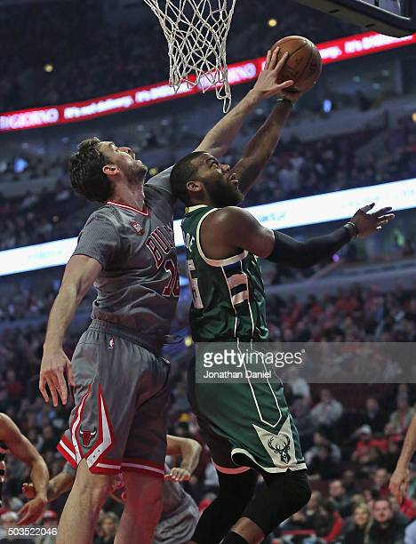 Pau Gasol of the Chicago Bulls blocks a shot by Greg Monroe of the Milwaukee Bucks at the United Center on January 5 2016 in Chicago Illinois NOTE TO...