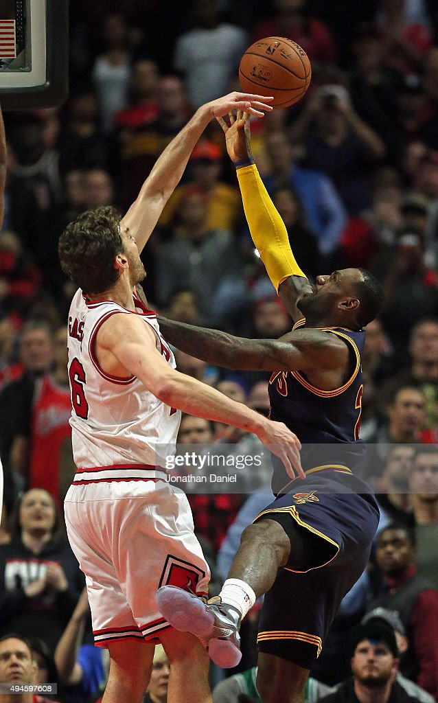 <a gi-track='captionPersonalityLinkClicked' href=/galleries/search?phrase=Pau+Gasol&family=editorial&specificpeople=201587 ng-click='$event.stopPropagation()'>Pau Gasol</a> #16 of the Chicago Bulls blocks a shot by <a gi-track='captionPersonalityLinkClicked' href=/galleries/search?phrase=LeBron+James&family=editorial&specificpeople=201474 ng-click='$event.stopPropagation()'>LeBron James</a> #23 of the Cleveland Cavaliers in the final 10 seconds during the season opening game at the United Center on October 27, 2015 in Chicago, Illinois. The Bulls defeated the Cavaliers 97-95. Note to User: User expressly acknowledges and agrees that, by downloading and or using the photograph, User is consenting to the terms and conditions of the Getty Images License Agreement.