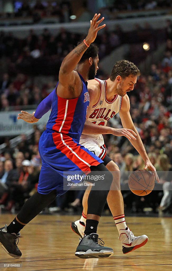 Pau Gasol #16 of the Chicago Bulls drives against Andre Drummond #0 of the Detroit Pistons at the United Center on December 18, 2015 in Chicago, Illinois. The Pistons defeated the Bulls 147-144 in quadruple overtime.