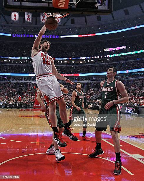 Pau Gasol of the Chicago Bulls dunks over Ersan Ilyasova of the Milwaukee Bucks during the first round of the 2015 NBA Playoffs at the United Center...