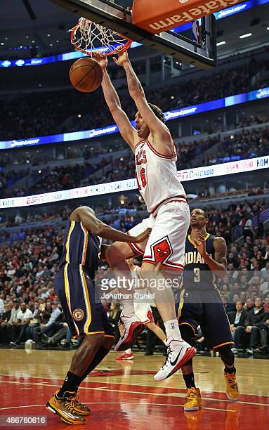 Pau Gasol of the Chicago Bulls dunks over Rodney Stuckey and George Hill of the Indiana Pacers at the United Center on March 18 2015 in Chicago...