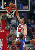 Pau Gasol of the Chicago Bulls dunks over Serge Ibaka of the Oklahoma City Thunder at the United Center on March 5 2015 in Chicago Illinois NOTE TO...
