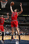 Pau Gasol of the Chicago Bulls grabs a rebound against the Memphis Grizzlies on December 19 2014 at the FedExForum in Memphis Tennessee NOTE TO USER...