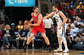 Pau Gasol of the Chicago Bulls handles the ball against Marc Gasol of the Memphis Grizzlies on December 19 2014 at the FedExForum in Memphis...