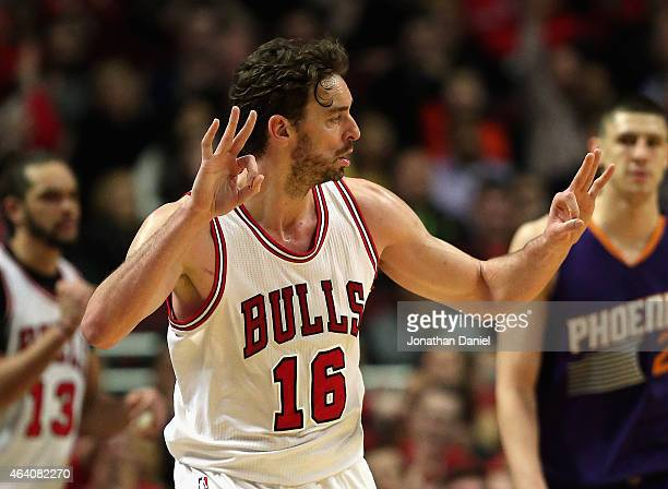 Pau Gasol of the Chicago Bulls holds up his fingers after hitting a threepoint shot on his way to a gamehigh 22 points against the Phoenix Suns at...