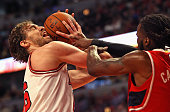 Pau Gasol of the Chicago Bulls is fouled by DeMarre Carroll of the Atlanta Hawks at the United Center on April 15 2015 in Chicago Illinois NOTE TO...