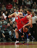 Pau Gasol of the Chicago Bulls is fouled by his brother Marc Gasol of the Memphis Grizzlies at the United Center on December 16 2015 in Chicago...