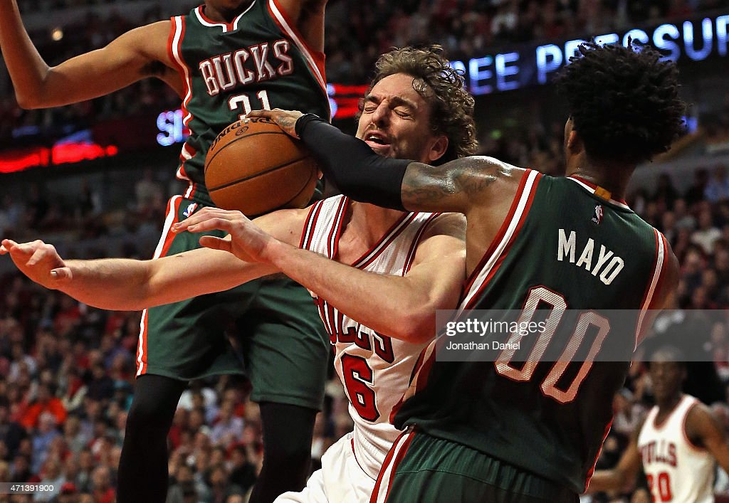 <a gi-track='captionPersonalityLinkClicked' href=/galleries/search?phrase=Pau+Gasol&family=editorial&specificpeople=201587 ng-click='$event.stopPropagation()'>Pau Gasol</a> #16 of the Chicago Bulls is fouleds by <a gi-track='captionPersonalityLinkClicked' href=/galleries/search?phrase=O.J.+Mayo&family=editorial&specificpeople=2351505 ng-click='$event.stopPropagation()'>O.J. Mayo</a> #00 of the Milwaukee Bucks during the first round of the 2015 NBA Playoffs at the United Center on April 27, 2015 in Chicago, Illinois. The Bucks defeated the Bulls 94-88.