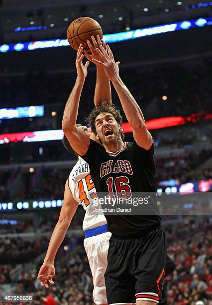 Pau Gasol of the Chicago Bulls is hit in the head by Cole Aldrich of the New York Knicks as he rebounds at the United Center on March 28 2015 in...