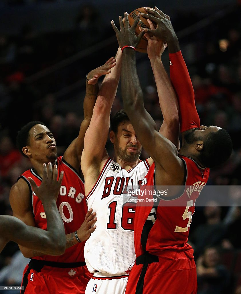 Pau Gasol #16 of the Chicago Bulls is trapped by DeMar DeRozan #10 and Patrick Patterson #54 of the Toronto Raptors at the United Center on December 28, 2015 in Chicago, Illinois. The Bulls defeated the Raptors 104-97.