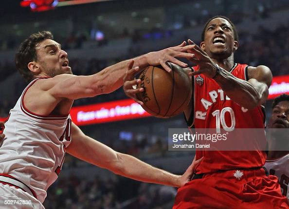 Pau Gasol of the Chicago Bulls knocks the ball away from DeMar DeRozan of the Toronto Raptors at the United Center on December 28 2015 in Chicago...