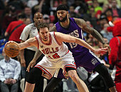 Pau Gasol of the Chicago Bulls moves against DeMarcus Cousins of the Sacramento Kings at the United Center on March 21 2016 in Chicago Illinois NOTE...