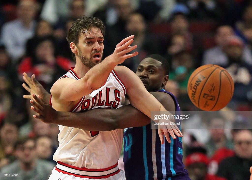 Pau Gasol #16 of the Chicago Bulls passes under pressure from Jason Maxiell #54 of the Charlotte Hornets at the United Center on February 25, 2015 in Chicago, Illinois.
