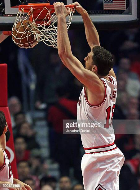 Pau Gasol of the Chicago Bulls playing in his 1000 career regular season game dunks against the Charlotte Hornets at the United Center on December 5...