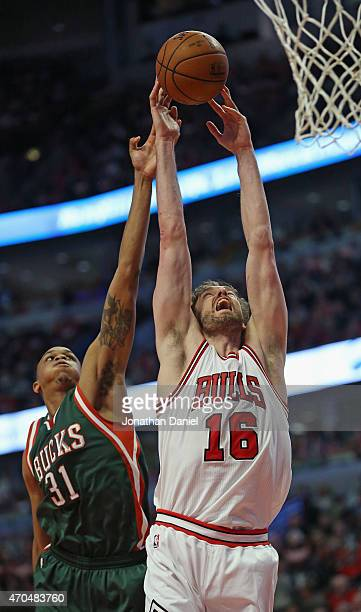Pau Gasol of the Chicago Bulls rebounds over John Henson of the Milwaukee Bucks during the first round of the 2015 NBA Playoffs at the United Center...