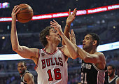 Pau Gasol of the Chicago Bulls shoots agaist Tim Duncan of the San Antonio Spurs at the United Center on November 30 2015 in Chicago Illinois Note to...