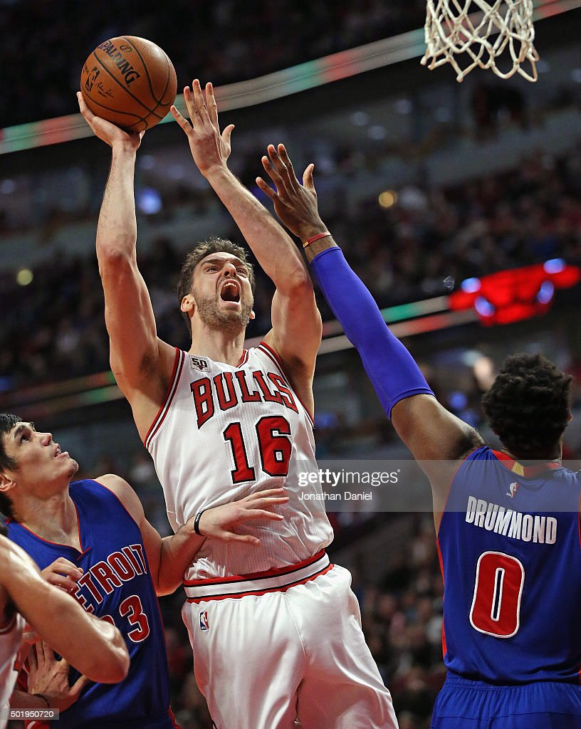 Pau Gasol #16 of the Chicago Bulls shoots between Ersan Ilyasova #23 and Andre Drummond #0 of the Detroit Pistons at the United Center on December 18, 2015 in Chicago, Illinois. The Pistons defeated the Bulls 147-144 in quadruple overtime.