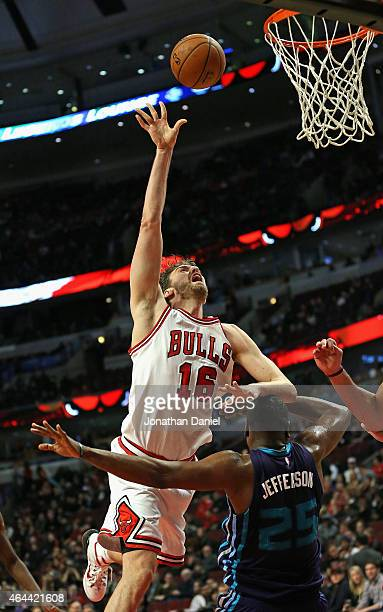 Pau Gasol of the Chicago Bulls shoots over Al Jefferson of the Charlotte Hornets on his way to a gamehigh 25 points at the United Center on February...