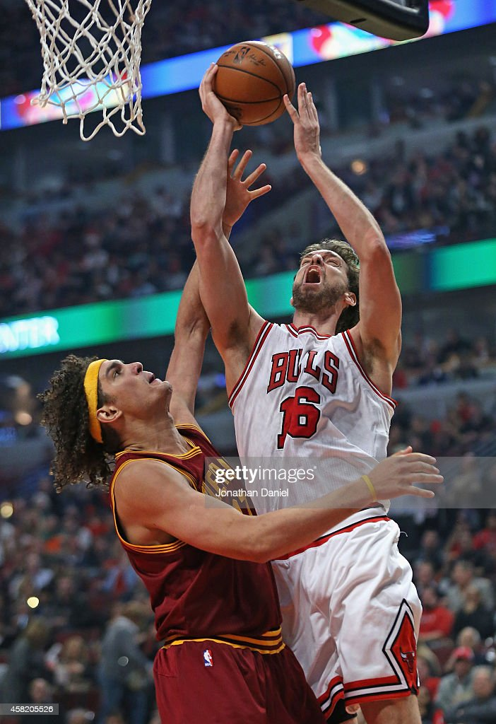 <a gi-track='captionPersonalityLinkClicked' href=/galleries/search?phrase=Pau+Gasol&family=editorial&specificpeople=201587 ng-click='$event.stopPropagation()'>Pau Gasol</a> #16 of the Chicago Bulls shoots over <a gi-track='captionPersonalityLinkClicked' href=/galleries/search?phrase=Anderson+Varejao&family=editorial&specificpeople=202247 ng-click='$event.stopPropagation()'>Anderson Varejao</a> #17 of the Cleveland Cavaliers at the United Center on October 31, 2014 in Chicago, Illinois. The Cavaliers defeated the Bulls 114-108 in overtime.