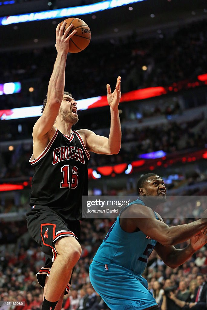 Pau Gasol of the Chicago Bulls shoots over Jason Maxiell of the Charlotte Hornetsaat the United Center on March 23 2015 in Chicago Illinois The Bulls...
