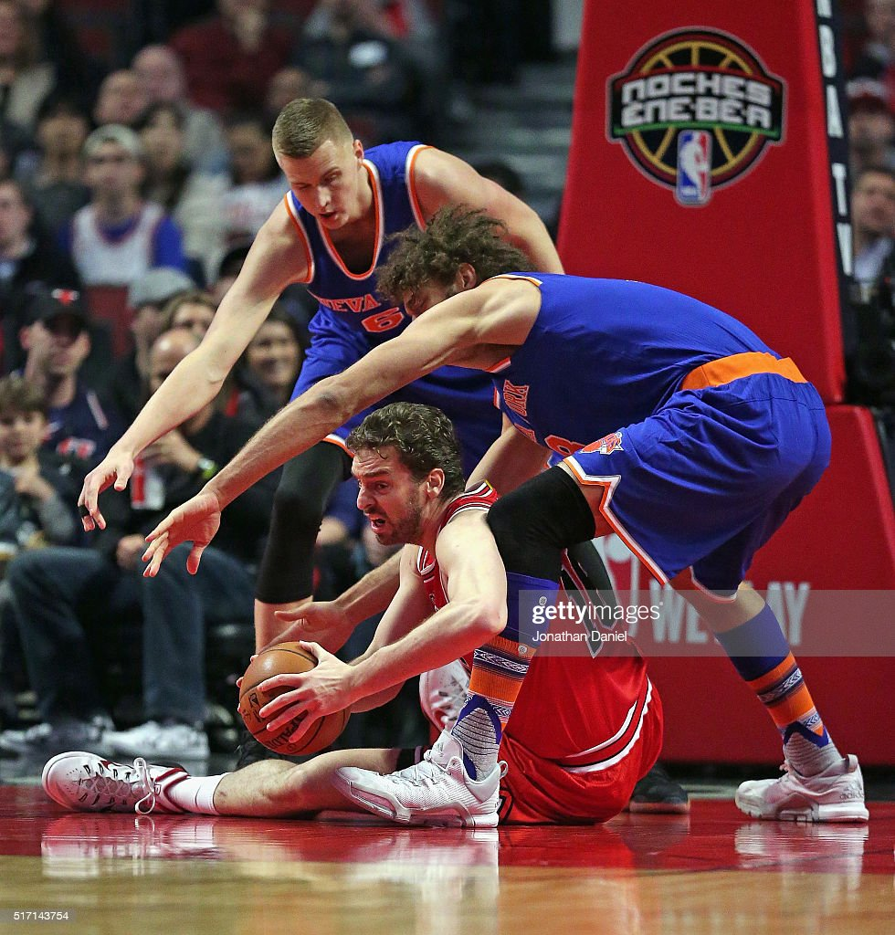 Pau Gasol of the Chicago Bulls tries to get off a pass from the floor under pressure from Robin Lopez and Kristaps Porzingis of the New York Knicks...