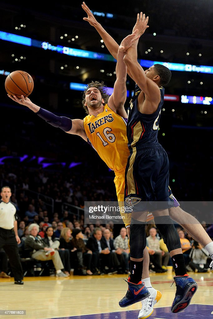 <a gi-track='captionPersonalityLinkClicked' href=/galleries/search?phrase=Pau+Gasol&family=editorial&specificpeople=201587 ng-click='$event.stopPropagation()'>Pau Gasol</a> #16 of the Los Angeles attempts a shot against Anthony Davis #23 of the New Orleans Pelicans at Staples Center on November 12, 2013 in Los Angeles, California.
