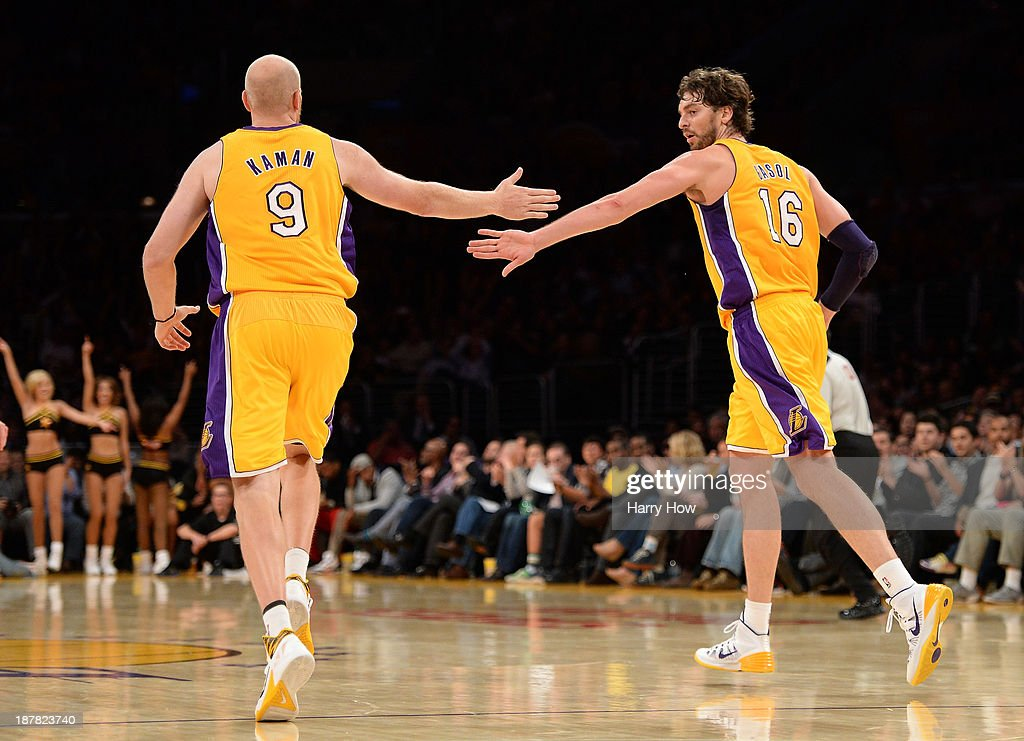 Pau Gasol #16 of the Los Angeles Lakers and Chris Kaman #9 celebrate a scoring play during a 116-95 win over the New Orleans Pelicans at Staples Center on November 12, 2013 in Los Angeles, California.