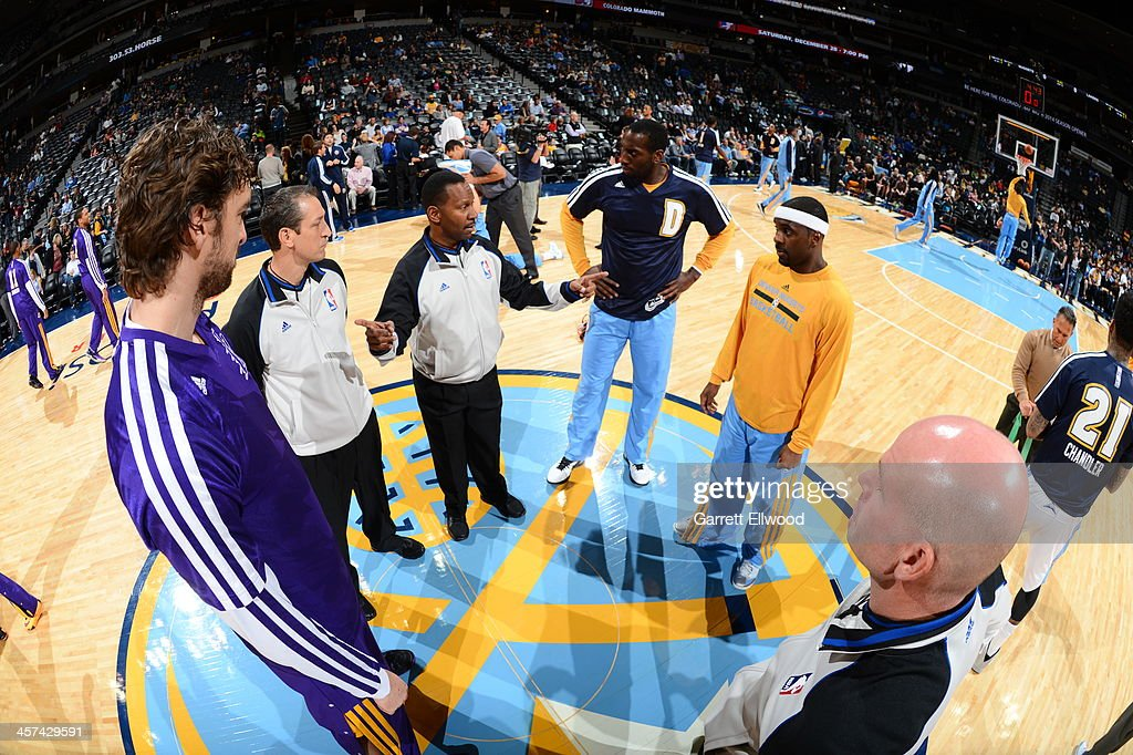 <a gi-track='captionPersonalityLinkClicked' href=/galleries/search?phrase=Pau+Gasol&family=editorial&specificpeople=201587 ng-click='$event.stopPropagation()'>Pau Gasol</a> #16 of the Los Angeles Lakers and <a gi-track='captionPersonalityLinkClicked' href=/galleries/search?phrase=Ty+Lawson&family=editorial&specificpeople=4024882 ng-click='$event.stopPropagation()'>Ty Lawson</a> #3 of the Denver Nuggets walk out before the game on November 13, 2013 at the Pepsi Center in Denver, Colorado.